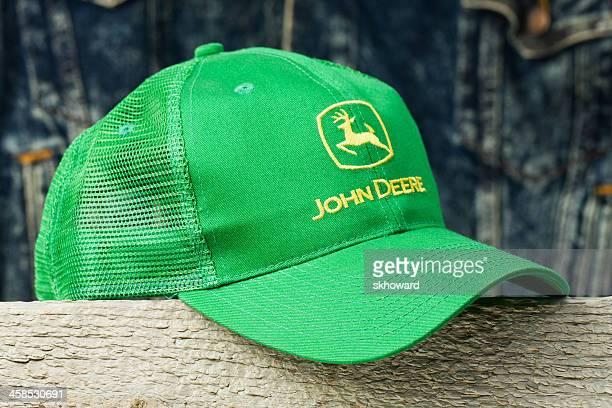 john deere cap on wood block - john deere stock pictures, royalty-free photos & images