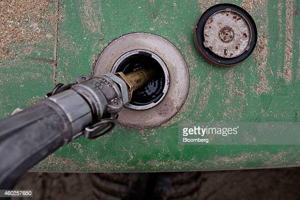 A John Deere Co tractor is filled with diesel fuel in Manlius Illinois US on Wednesday Dec 10 2014 Gasoline supplies rose 82 million barrels to 2168...