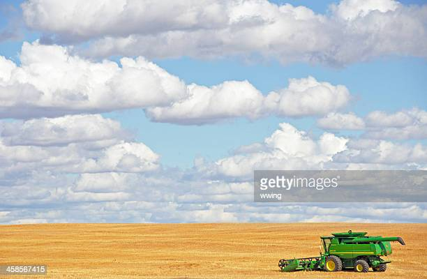 john deere combine  .. distant side view - john deere stock pictures, royalty-free photos & images