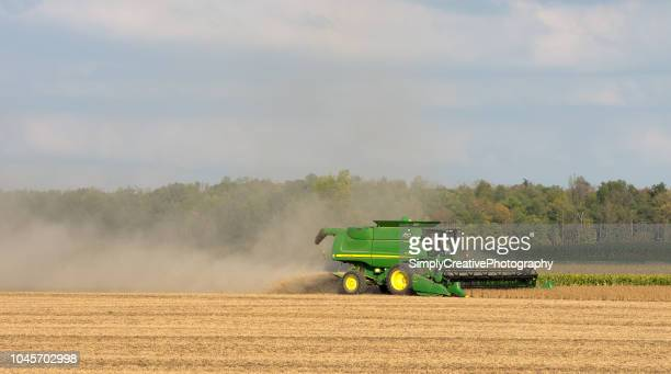 john deere combine harvesting soy beans - john deere stock pictures, royalty-free photos & images