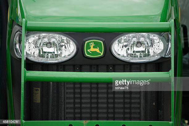 john deere logo on the grill of a new tractor - john deere stock pictures, royalty-free photos & images
