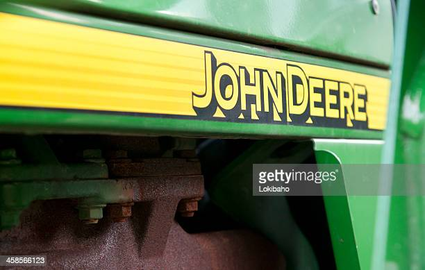 john deere logo with horizontal yellow stripe - john deere stock pictures, royalty-free photos & images