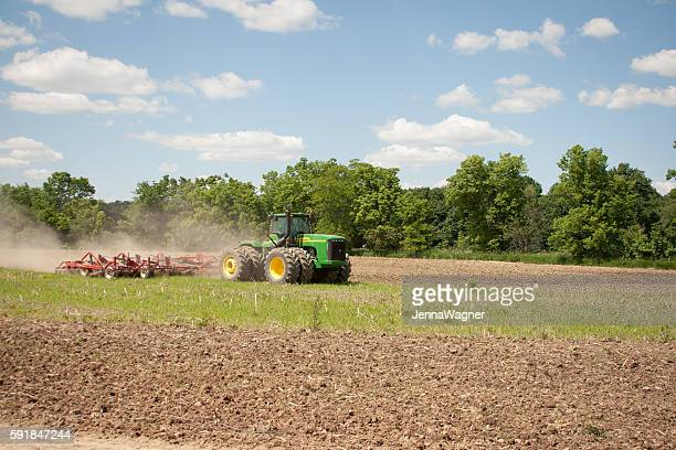 john deere tilling field - john deere stock pictures, royalty-free photos & images