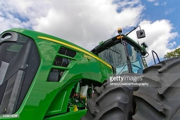 john deere tractor closeup - john deere stock pictures, royalty-free photos & images