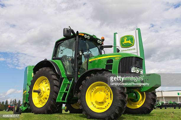 john deere tractor on sales lot - john deere stock pictures, royalty-free photos & images