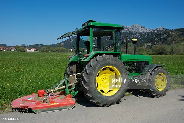 john deere tractor parked - john deere stock pictures, royalty-free photos & images