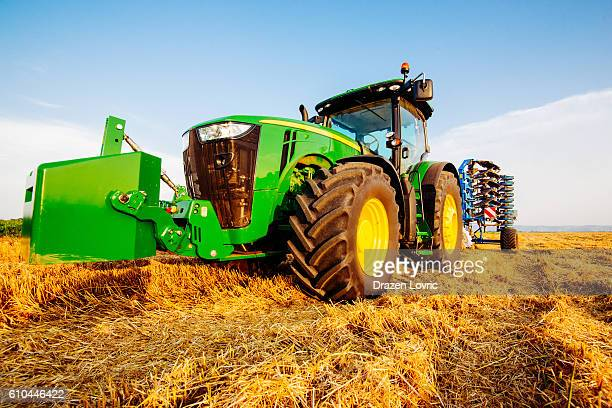 john deere tractor with plow - john deere stock pictures, royalty-free photos & images