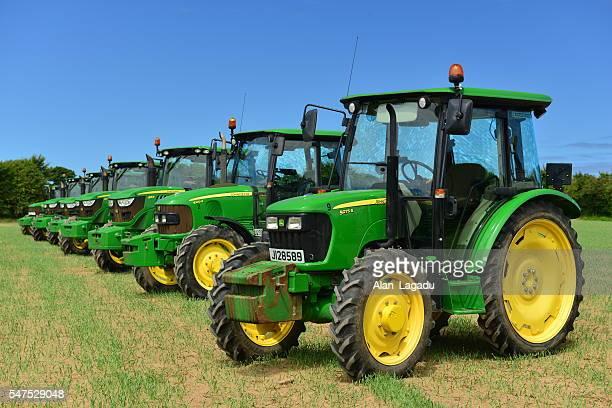 john deere tractors, jersey, u.k. - john deere tractor stock photos and pictures