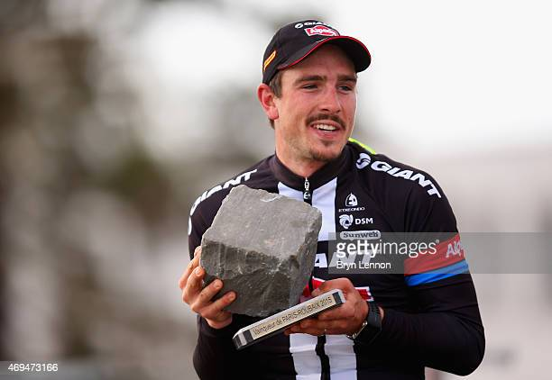 John Degenkolb of Germany and Team Giant-Alpecin celebrates winning the 113th edition of the Paris-Roubaix cycle race from Paris to Roubaix on April...