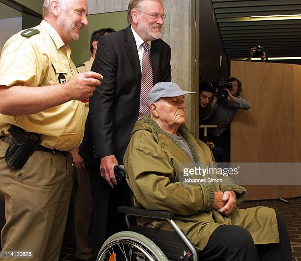 John Demjanjuk and his lawyer Ulrich Busch emerges from a Munich court after a judge sentenced him to 5 years in prison for charges related to 28060...