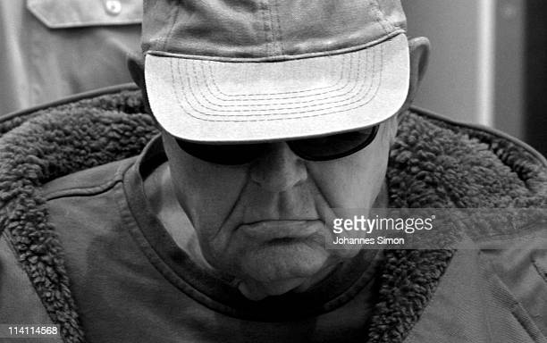 John Demjanjuk listens as a court reads out its verdict pronouncing him guilty of 28060 counts of accessory to murder on May 12 2011 in Munich...