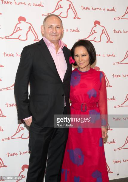 John Demsey and Alina Cho attend 'Take Home A Nude' New York Academy of Art benefit at Sotheby's on October 9 2018 in New York City