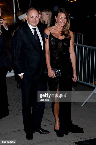 John Demsey and Kelly Bensimon attend the '2016 amfAR' New York Gala outside arrivals at Cipriani Wall Street in New York City �� LAN