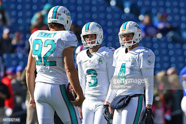 John Denney Andrew Franks and Matt Darr of the Miami Dolphins talk prior to the game against the Buffalo Bills at Ralph Wilson Stadium on November 8...