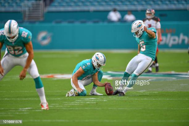John Denney Matt Haack Greg Joseph of the Miami Dolphins warm up before a preseason game against the Tampa Bay Buccaneers at Hard Rock Stadium on...
