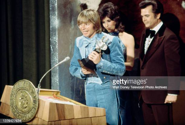 John Denver accepting his award for Album of the Year, Donna Fargo, Conway Twitty, appearing on the ABC tv special '1976 / 11th Academy of Country...