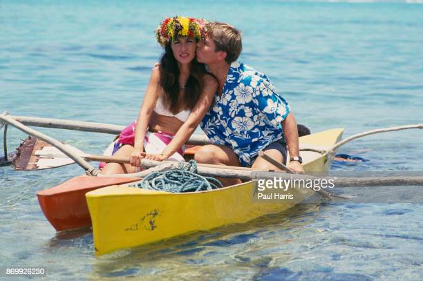 John Denver kissing Australian actress Cassandra Delaney who he married in 1988 at the Bob Hope TV special called ' Bob Hopes Tropical Comedy from...