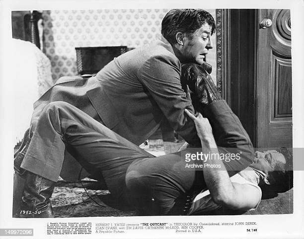John Derek is attacked by man in a scene from the film 'The Outcast', 1954.