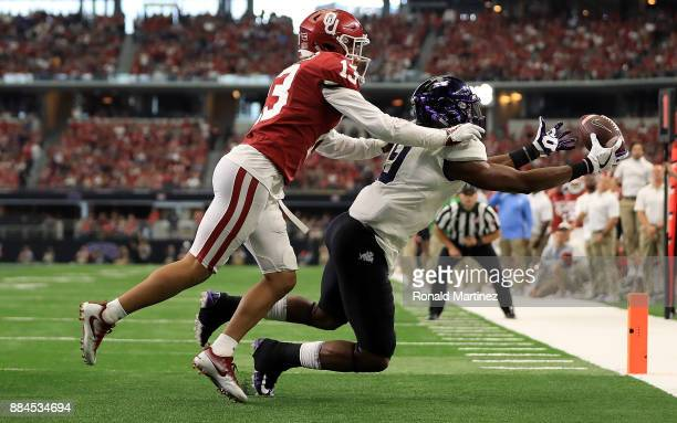 John Diarse of the TCU Horned Frogs makes a touchdown pass reception against Tre Norwood of the Oklahoma Sooners in the second quarter during Big 12...