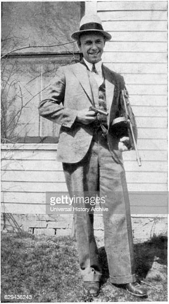 John Dillinger American Gangster Portrait holding Toy Gun Used to Escape Jail in Crown Point Indiana USA 1934