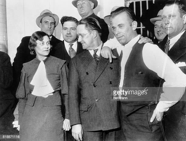 John Dillinger at Crown Point Indiana jail where he was returned after his capture in Tucson Arizon Left to right Sheriff Lillian Holley Prosecuting...