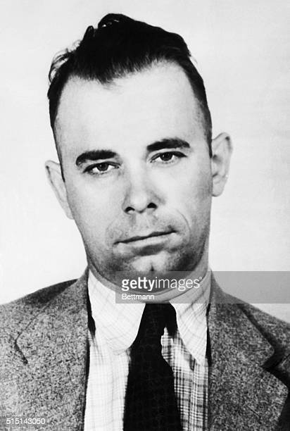 John Dillinger exconvict and alleged leader of a bandit ring is being held with his sweetheart Mary Longneck at Dayton Ohio for Indiana police in...