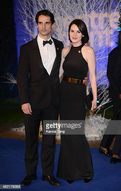 John Dineen and Michelle Dockery attend the Winter Whites Gala in aid of Centrepoint at Kensington Palace on November 26 2013 in London England
