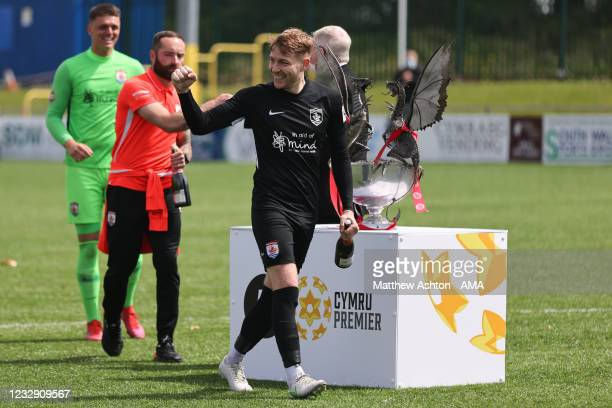 John Disney celebrates winning the Welsh / Cymru Welsh Premier trophy awarded to the champions of the league during the Cymru Welsh Premier League...