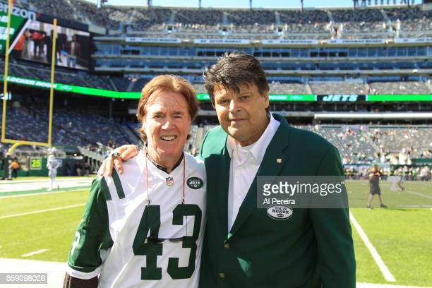 John Dockery and Mark Gastineau former players of the New York Jets meet before the game against the Jacksonville Jaguars during their game at...