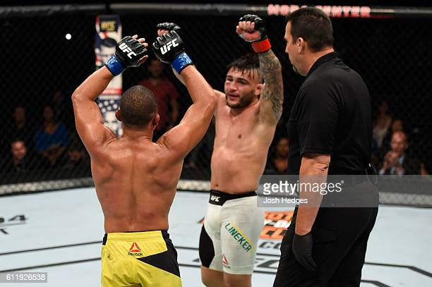 John Dodson and John Lineker of Brazil raise their hands after going five rounds in their bantamweight bout during the UFC Fight Night event at the...