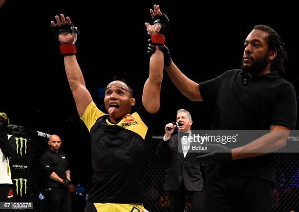 John Dodson celebrates after his unanimousdecision victory over Eddie Wineland in their bantamweight bout during the UFC Fight Night event at...