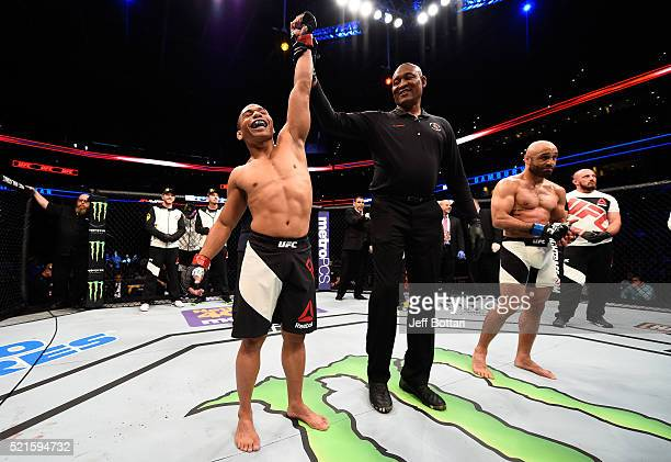 John Dodson celebrates his knockout victory over Manny Gamburyan in their flyweight bout during the UFC Fight Night event at Amalie Arena on April 16...