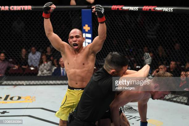 John Dodson celebrates his TKO victory over Nathaniel Wood of United Kingdom in their bantamweight bout during the UFC Fight Night event at Santa Ana...