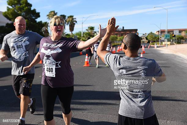 John Dodson interacts with particpants during the UltiMan 5K event at Town Square on July 9 2016 in Las Vegas Nevada