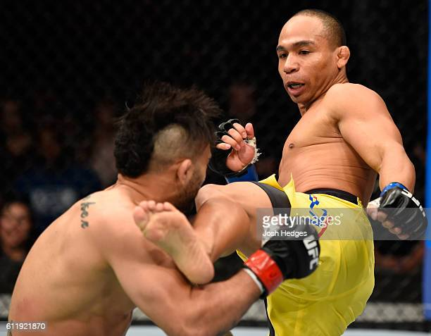 John Dodson lands a kick to the head of John Lineker of Brazil in their bantamweight bout during the UFC Fight Night event at the Moda Center on...