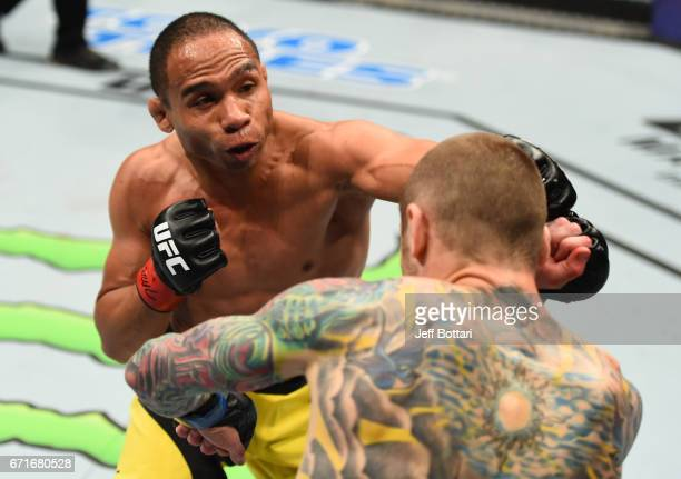 John Dodson punches Eddie Wineland in their bantamweight bout during the UFC Fight Night event at Bridgestone Arena on April 22 2017 in Nashville...