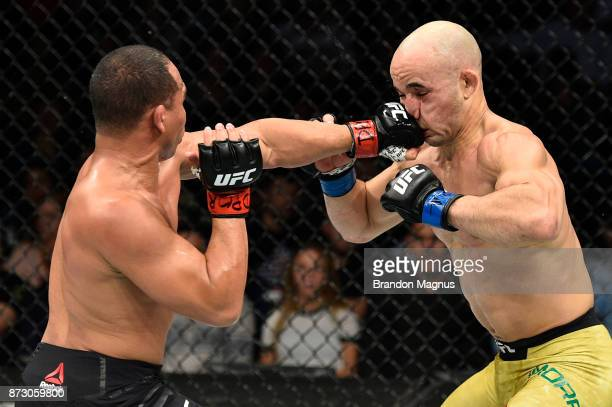 John Dodson punches Marlon Moraes of Brazil in their bantamweight bout during the UFC Fight Night event inside the Ted Constant Convention Center on...