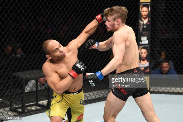 John Dodson punches Nathaniel Wood of United Kingdom in their bantamweight bout during the UFC Fight Night event at Santa Ana Star Center on February...