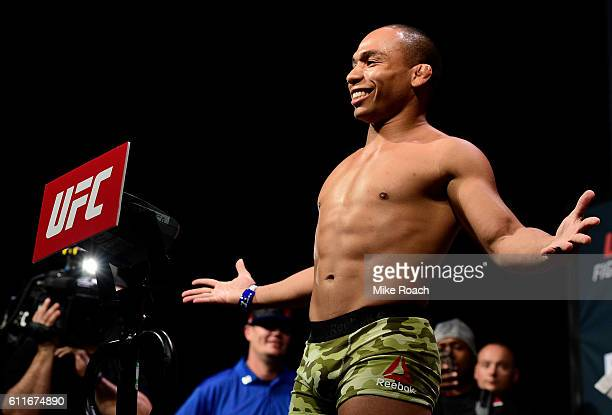 John Dodson steps onto the scale during the UFC Fight Night weighin at the Oregon Convention Center on September 30 2016 in Portland Oregon