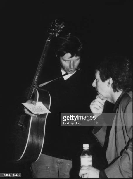 John Doe and Harry Shearer confer in tight backstage space before each performs at the ACLU Grammy Party fundraiser at Luna Park in West Hollywood on...