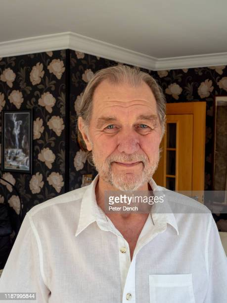 John Downing MBE in the living room of his home John's career has spanned over five decades and taken him to over 100 countries and all 7 continents...
