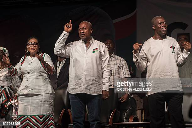 John Dramani Mahama president of Ghana and Kwesi AmissahArthur Vice President of Ghana gesture as they attend in the Accra Sports Stadium on December...
