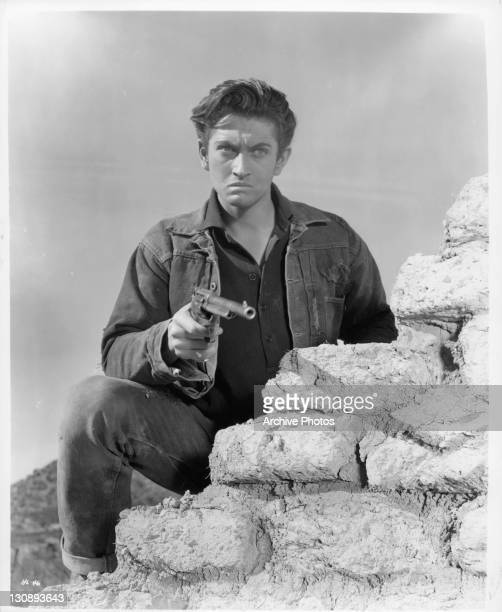 John Drew Barrymore holding gun in a scene from the film 'High Lonesome' 1950