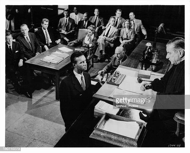 John Drew Barrymore listens as James Edwards makes a desperate plea to judge Robert Warwick in a scene from the film 'Night Of The Quarter Moon' 1959