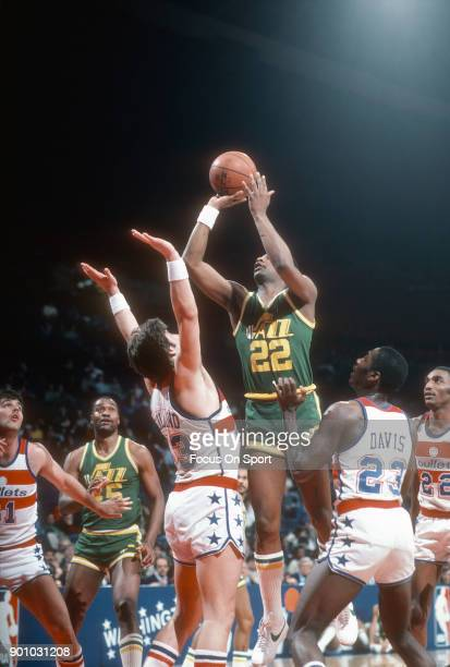 John Drew of the Utah Jazz shoots over Jeff Ruland of the Washington Bullets during an NBA basketball game circa 1983 at The Capital Centre in...