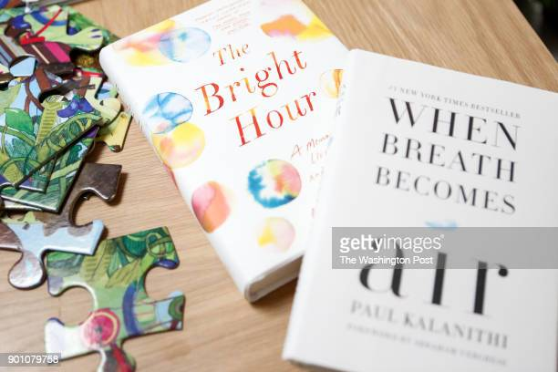 John Duberstein late wife's book is seen with Lucy Kalanithi's late husband's book in Kalanithi's home in San Mateo Ca on December 30 2017