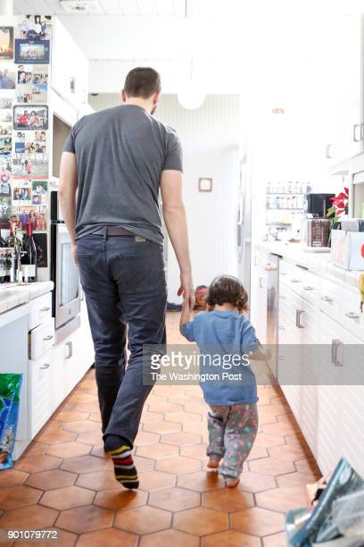 John Duberstein walks with Lucy Kalanithi's daughter Cady in Kalanithi's home in San Mateo Ca on December 30 2017 Duberstein's late wife Nina Riggs...