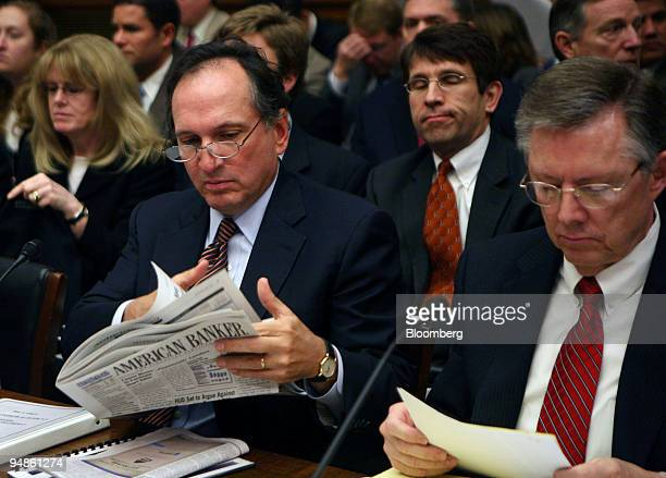 John Dugan comptroller Office of the Comptroller of the Currency left reads an issue of American Banker as John Reich director of the Office of...