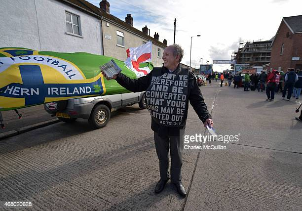 John Dumigan hands out religious tracts as the Evangelical Protestant Society hold a protest against football on a Sunday before the EURO 2016 Group...