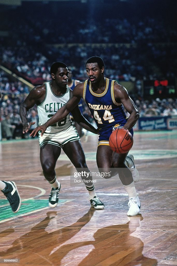 John Duren #44 of the Indiana Pacers drives the ball up court against Quinn Buckner #28 of the Boston Celtics during a game played in 1983 at the Boston Garden in Boston, Massachusetts.